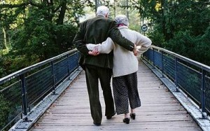 Elderly-couple-walking-across-footbridge-Photo-GETTY
