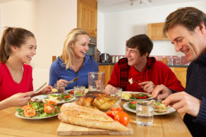 Teenage-Family-Eating-Lunch-To-38602666-2