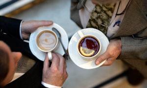two men drinking tea