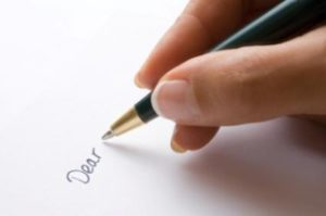 Person_writing_a_letter